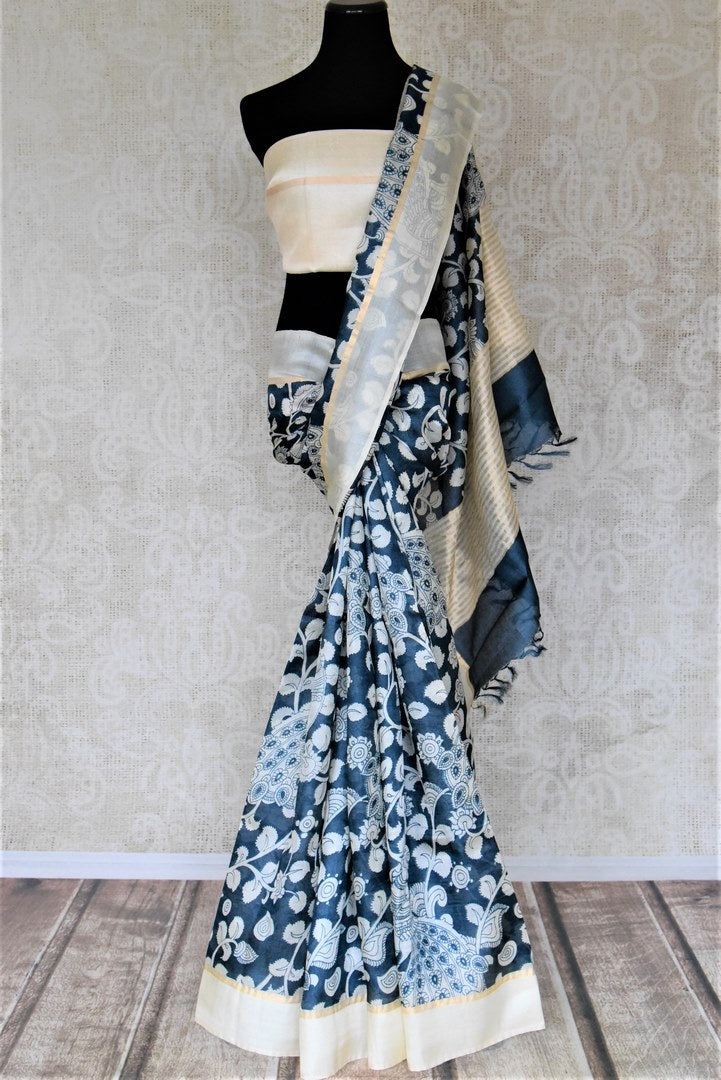 Buy black Kalamkari print tussar saree online in USA with cream border. Be the talk of the occasions in exquisite tassar sarees, handwoven silk saris from Pure Elegance Indian fashion store in USA. -full view