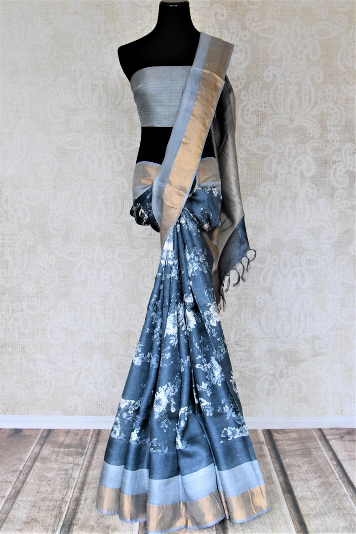 Shop blue floral print tassar saree online in USA with golden zari border. Be the talk of the occasions in exquisite tassar sarees, handwoven silk saris from Pure Elegance Indian fashion store in USA. -full view