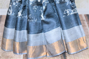 Shop blue floral print tassar saree online in USA with golden zari border. Be the talk of the occasions in exquisite tassar sarees, handwoven silk saris from Pure Elegance Indian fashion store in USA. -pleats