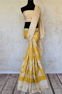 Shop yellow tassar saree online in USA with white floral print. Be the talk of the occasions in exquisite tassar sarees, handwoven silk saris from Pure Elegance Indian fashion store in USA. -full view
