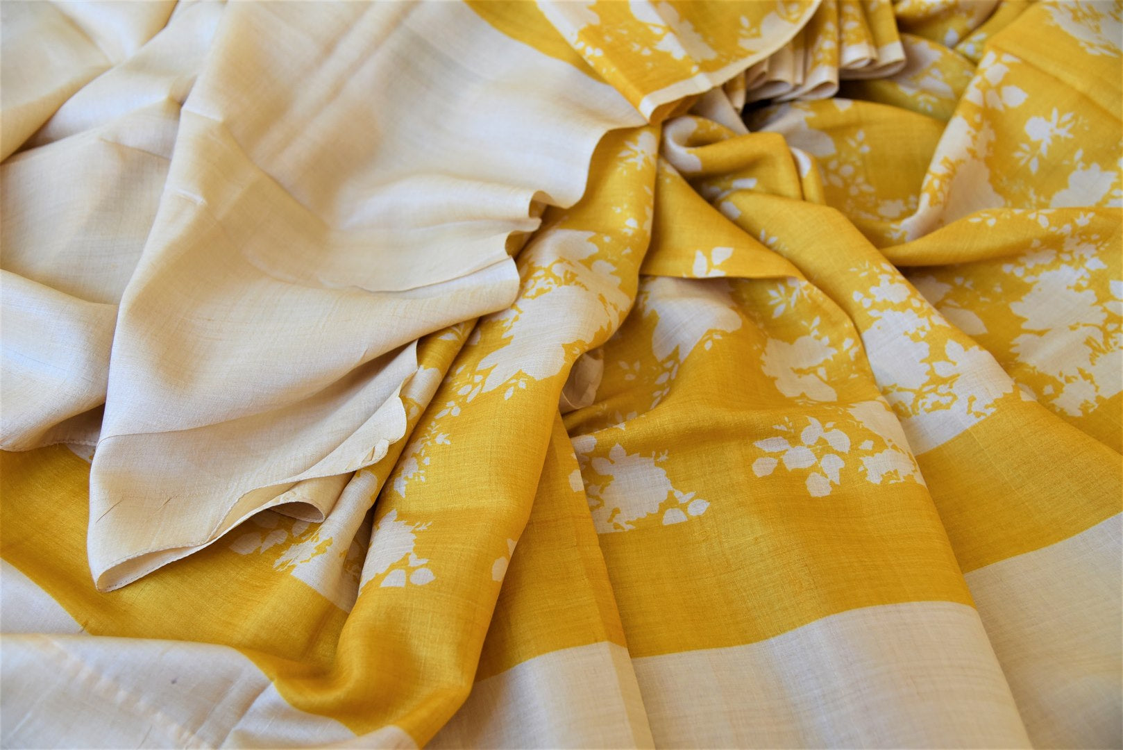Shop yellow tassar saree online in USA with white floral print. Be the talk of the occasions in exquisite tassar sarees, handwoven silk saris from Pure Elegance Indian fashion store in USA. -details
