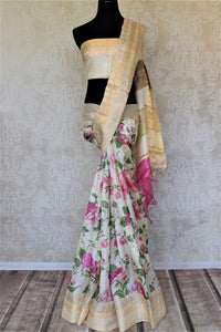 Shop charming off-white tassar sari online in USA with pink floral print. Be the talk of the occasions in exquisite tassar sarees, handwoven silk saris from Pure Elegance Indian fashion store in USA. -full view