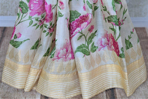 Shop charming off-white tassar sari online in USA with pink floral print. Be the talk of the occasions in exquisite tassar sarees, handwoven silk saris from Pure Elegance Indian fashion store in USA. -pleats