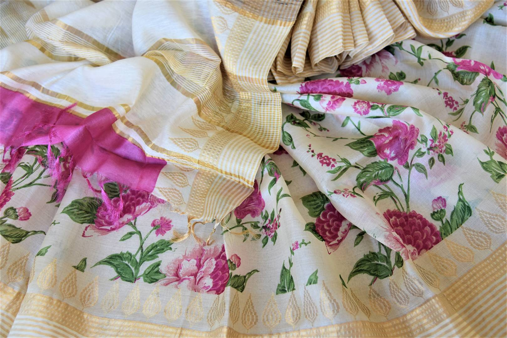 Shop charming off-white tassar sari online in USA with pink floral print. Be the talk of the occasions in exquisite tassar sarees, handwoven silk saris from Pure Elegance Indian fashion store in USA. -details