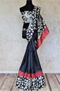 Buy charming black tassar silk saree online in USA with printed red border. Be the talk of the occasions in exquisite tassar sarees, handwoven silkiew saris from Pure Elegance Indian fashion store in USA. -full v