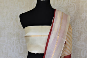 Shop elegant off-white and red stripes tassar silk saree online in USA. Be the talk of the occasions in exquisite tassar sarees, handwoven silk saris from Pure Elegance Indian fashion store in USA. -blouse pallu
