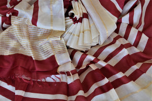 Shop elegant off-white and red stripes tassar silk saree online in USA. Be the talk of the occasions in exquisite tassar sarees, handwoven silk saris from Pure Elegance Indian fashion store in USA. -details