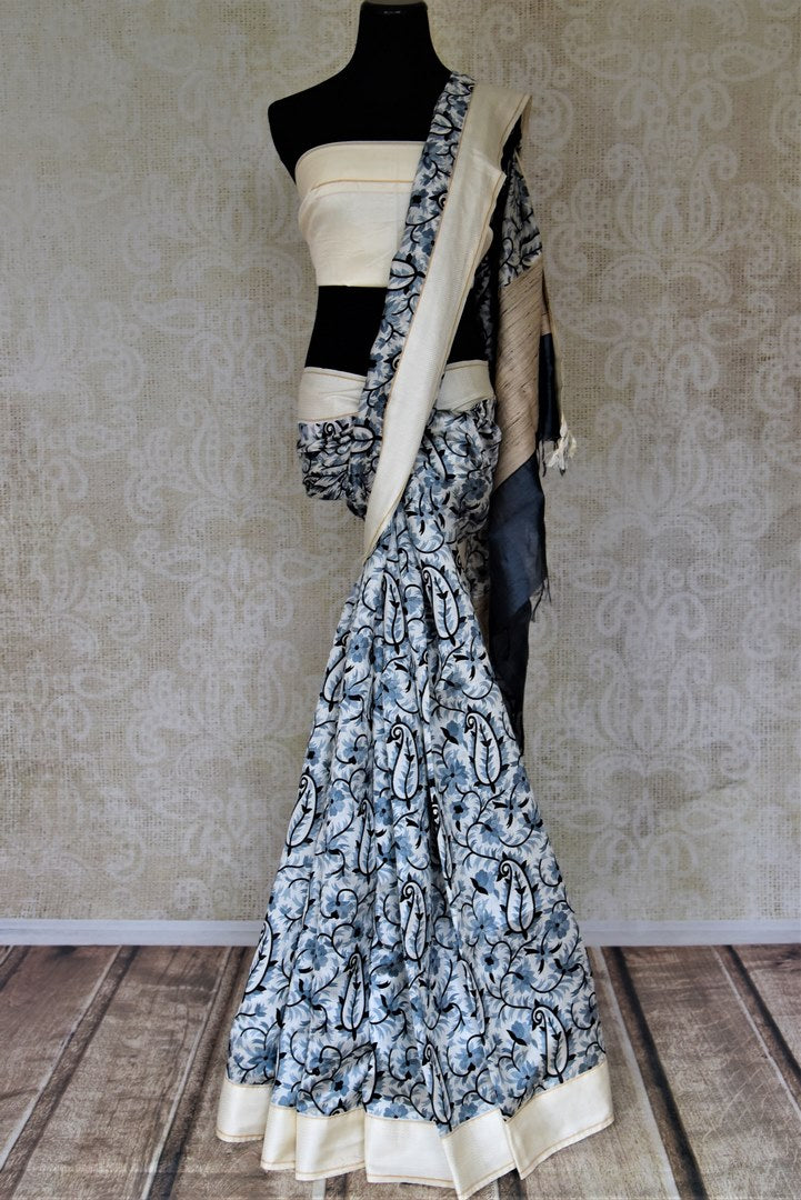 Shop lovely white printed tussar silk sari online in USA with cream border. Make a beautiful appearance on special occasions with exquisite Indian designer sarees, pure silk saris from Pure Elegance Indian fashion store in USA.-full view
