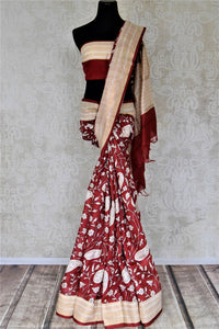 Shop alluring red printed tussar silk saree online in USA with striped cream border. Make a beautiful appearance on special occasions with exquisite Indian designer sarees, pure silk saris from Pure Elegance Indian fashion store in USA.-full view