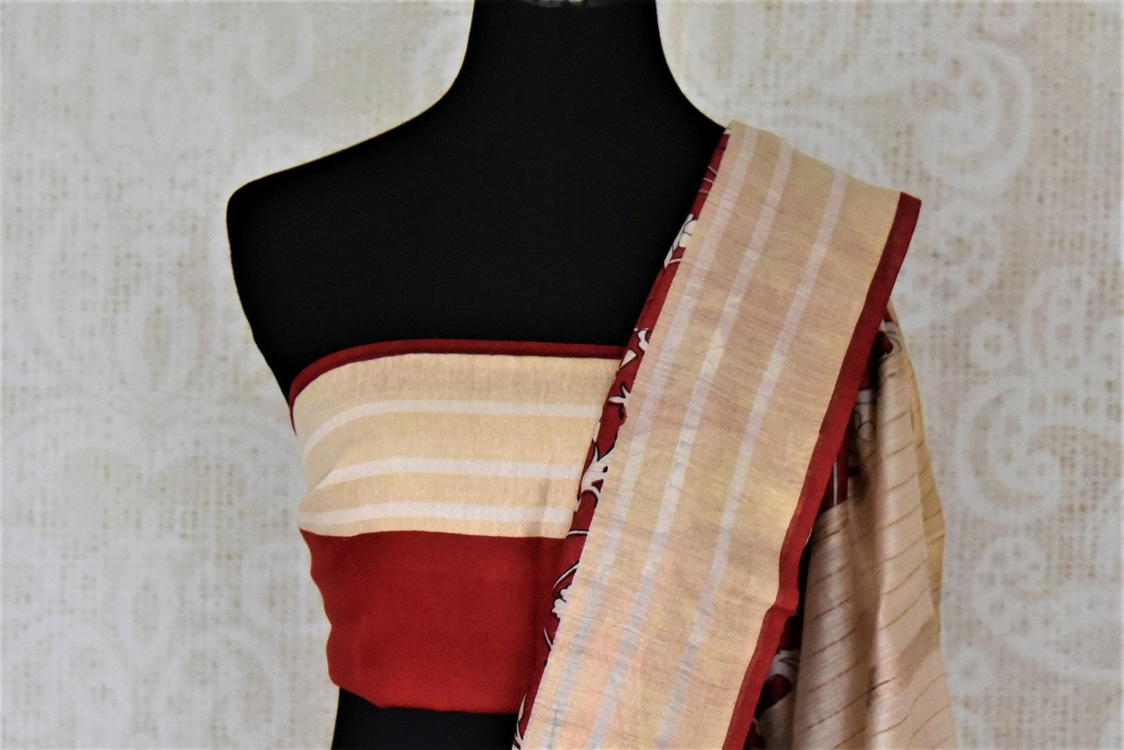 Shop alluring red printed tussar silk saree online in USA with striped cream border. Make a beautiful appearance on special occasions with exquisite Indian designer sarees, pure silk saris from Pure Elegance Indian fashion store in USA.-blouse pallu