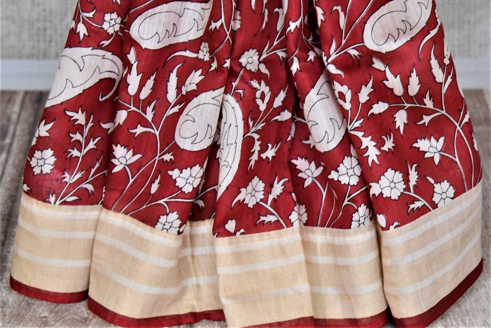 Shop alluring red printed tussar silk saree online in USA with striped cream border. Make a beautiful appearance on special occasions with exquisite Indian designer sarees, pure silk saris from Pure Elegance Indian fashion store in USA.-pleats