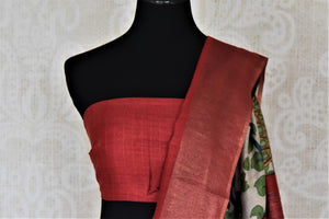 Buy elegant off-white peacock and floral print tussar silk saree online in USA with red border. Make a beautiful appearance on special occasions with exquisite Indian designer sarees, pure silk saris from Pure Elegance Indian fashion store in USA.-blouse pallu
