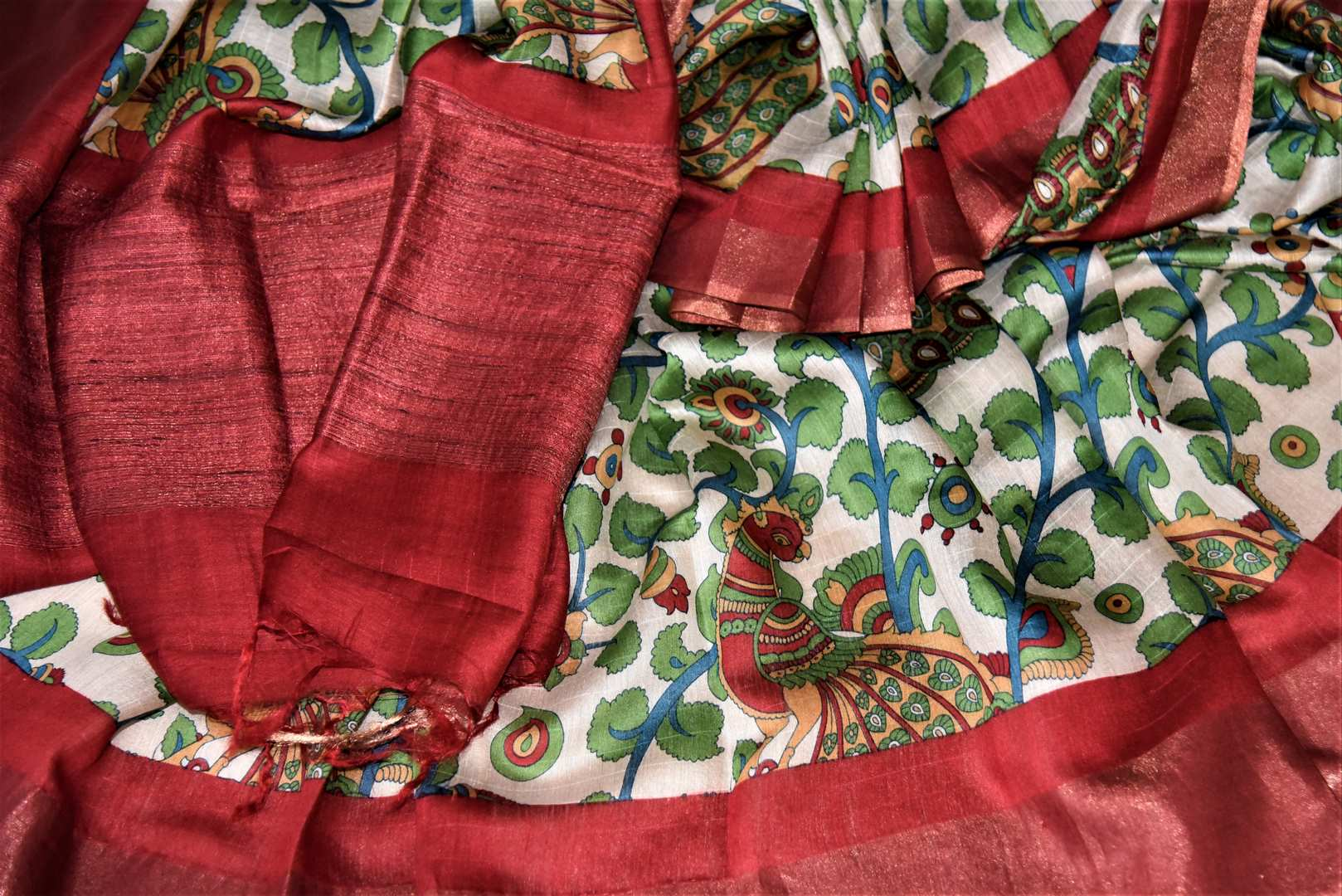 Buy elegant off-white peacock and floral print tussar silk saree online in USA with red border. Make a beautiful appearance on special occasions with exquisite Indian designer sarees, pure silk saris from Pure Elegance Indian fashion store in USA.-details