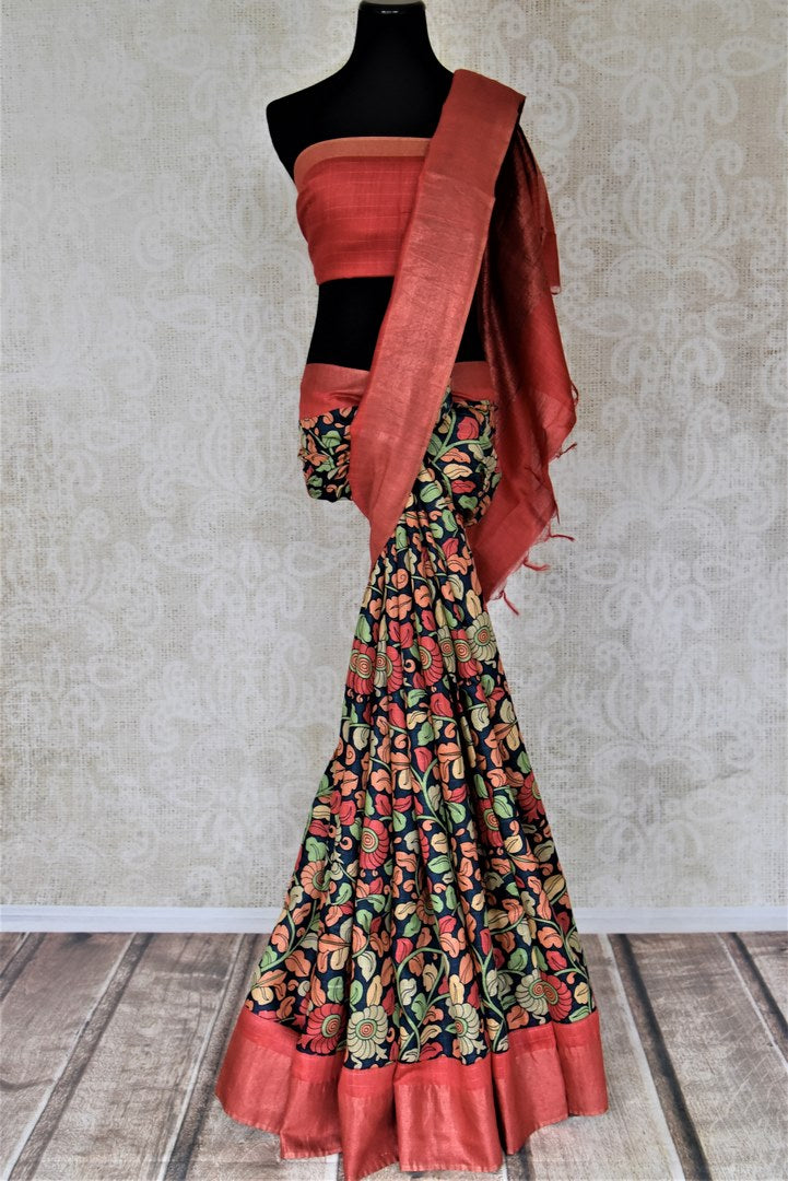 Buy navy blue floral print tussar silk saree online in USA with red light zari border. Make a beautiful appearance on special occasions with exquisite Indian designer sarees, pure silk saris from Pure Elegance Indian fashion store in USA.-full view