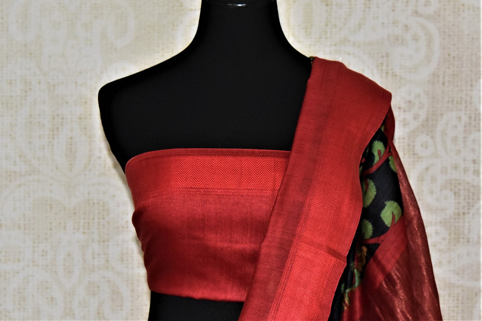 Shop ravishing black tussar silk saree online in USA with green floral print and red border. Make a beautiful appearance on special occasions with exquisite Indian designer sarees, pure silk saris from Pure Elegance Indian fashion store in USA.-blouse pallu