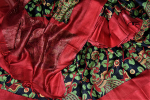 Shop ravishing black tussar silk saree online in USA with green floral print and red border. Make a beautiful appearance on special occasions with exquisite Indian designer sarees, pure silk saris from Pure Elegance Indian fashion store in USA.-details