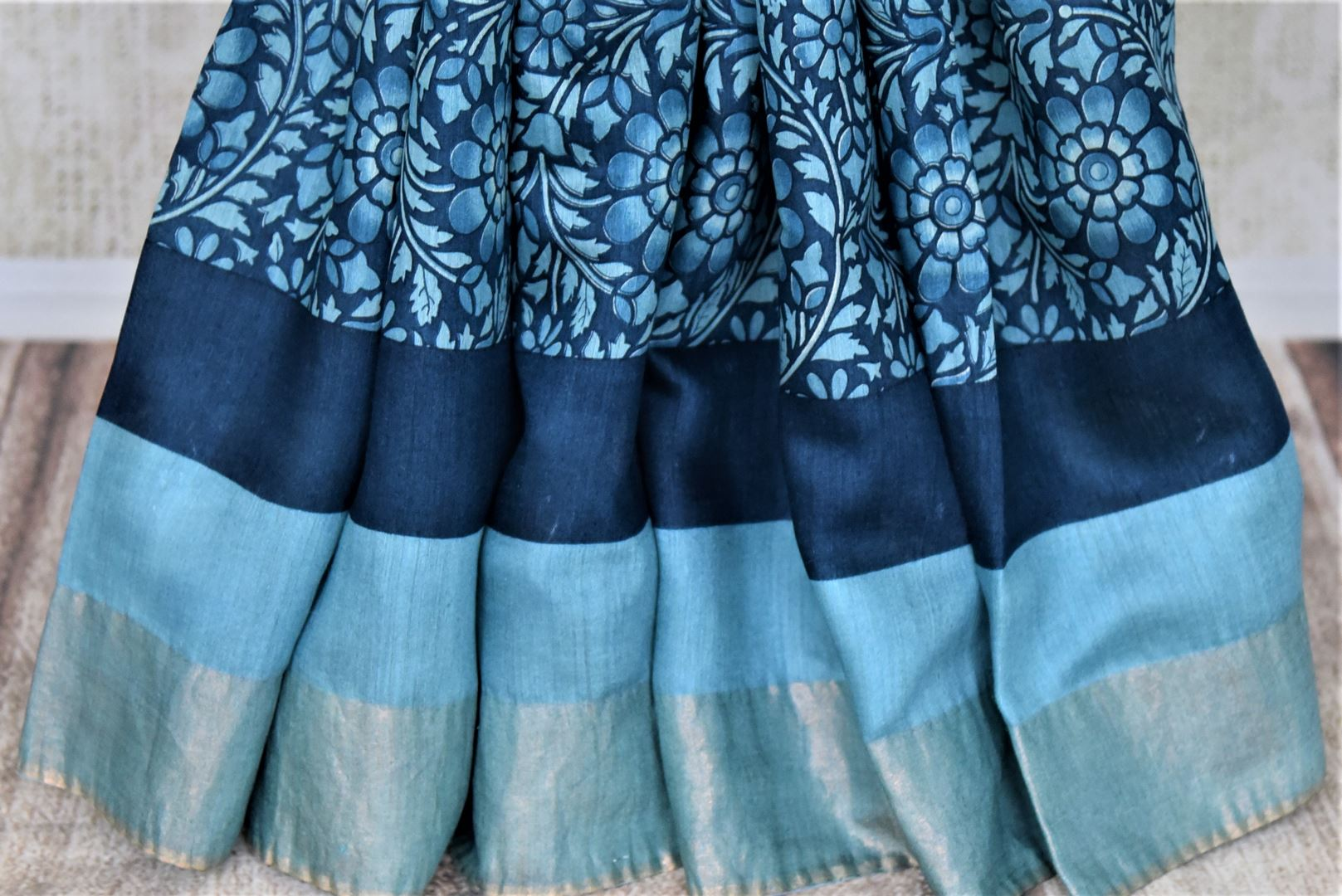 Shop lovely blue floral print tussar silk saree online in USA with light zari border. Make a beautiful appearance on special occasions with exquisite Indian designer saris, pure silk sarees from Pure Elegance Indian fashion store in USA.-pleats