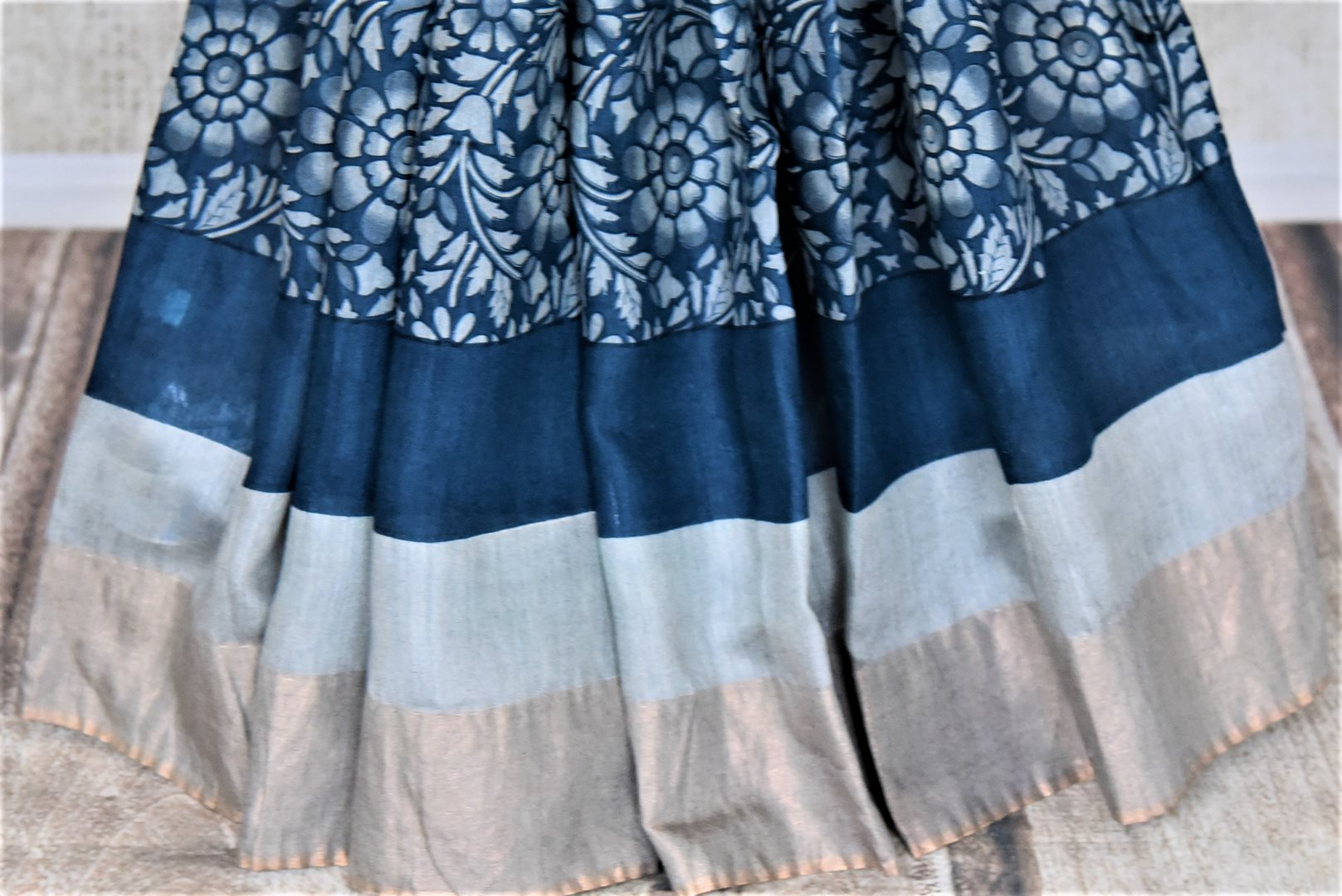 Buy dark blue floral print tussar silk sari online in USA with light zari border. Make a beautiful appearance on special occasions with exquisite Indian designer saris, pure silk sarees from Pure Elegance Indian fashion store in USA.-pleats
