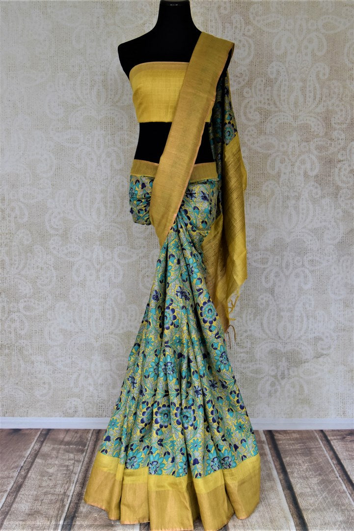 Shop stunning yellow tussar silk sari online in USA with blue floral print. Make a beautiful appearance on special occasions with exquisite Indian designer saris, pure silk sarees from Pure Elegance Indian fashion store in USA.-full view