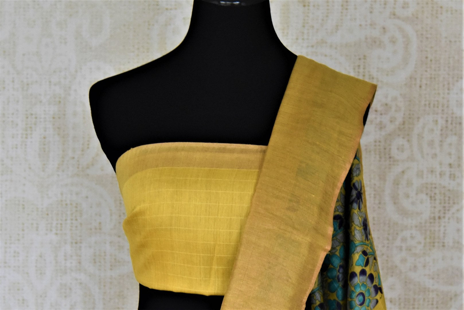 Shop stunning yellow tussar silk sari online in USA with blue floral print. Make a beautiful appearance on special occasions with exquisite Indian designer saris, pure silk sarees from Pure Elegance Indian fashion store in USA.-blouse pallu