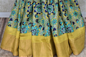 Shop stunning yellow tussar silk sari online in USA with blue floral print. Make a beautiful appearance on special occasions with exquisite Indian designer saris, pure silk sarees from Pure Elegance Indian fashion store in USA.-pleats