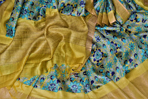 Shop stunning yellow tussar silk sari online in USA with blue floral print. Make a beautiful appearance on special occasions with exquisite Indian designer saris, pure silk sarees from Pure Elegance Indian fashion store in USA.-details