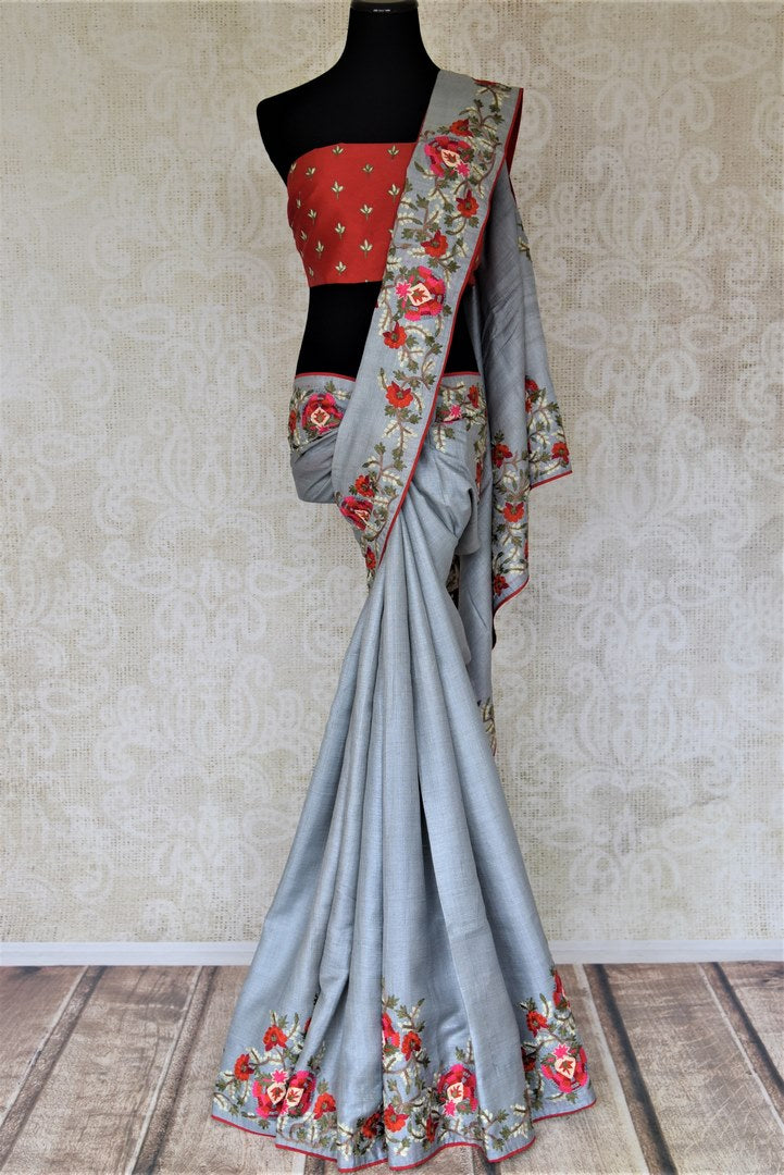 Shop steel grey tassar silk saree online in USA with embroidered border. Keep it light yet festive on special occasions with beautiful tussar silk saris from Pure Elegance Indian fashion store in USA.-full view
