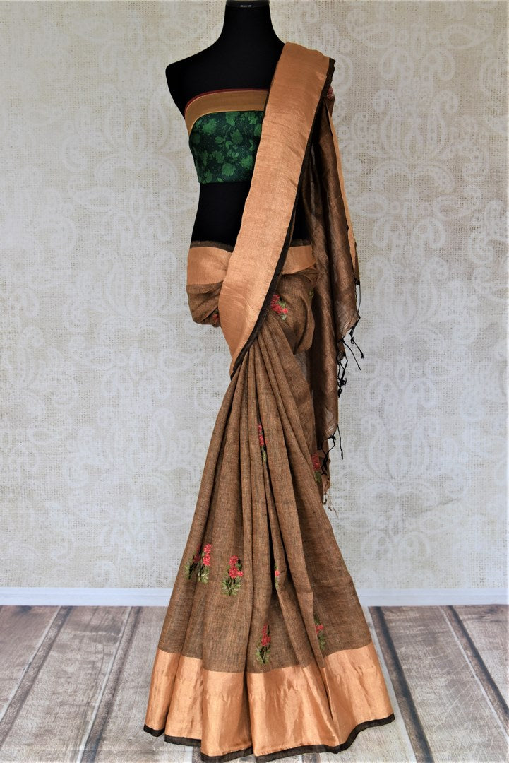 Buy gorgeous brown linen saree online in USA with embroidered floral motifs and zari border. Be the talk of the occasions in exquisite linen sarees, handwoven silk saris from Pure Elegance Indian fashion store in USA. -full view
