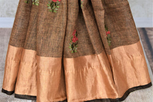 Buy gorgeous brown linen saree online in USA with embroidered floral motifs and zari border. Be the talk of the occasions in exquisite linen sarees, handwoven silk saris from Pure Elegance Indian fashion store in USA. -pleats