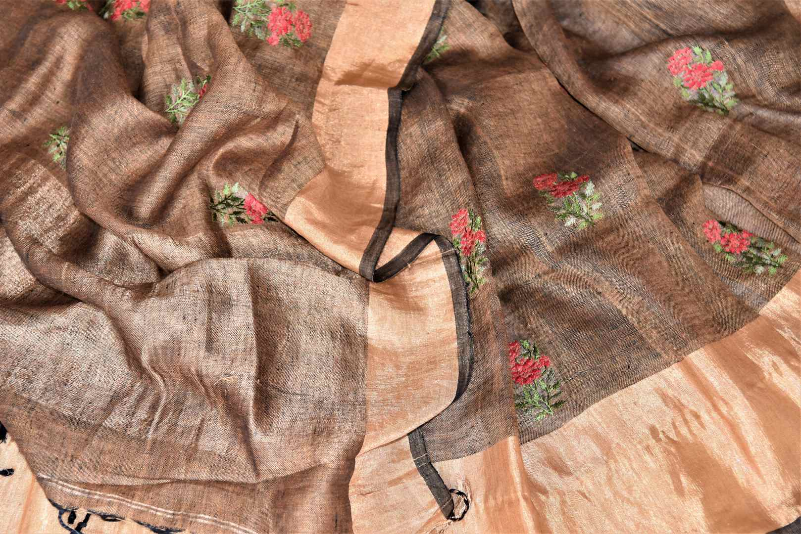 Buy gorgeous brown linen saree online in USA with embroidered floral motifs and zari border. Be the talk of the occasions in exquisite linen sarees, handwoven silk saris from Pure Elegance Indian fashion store in USA. -details