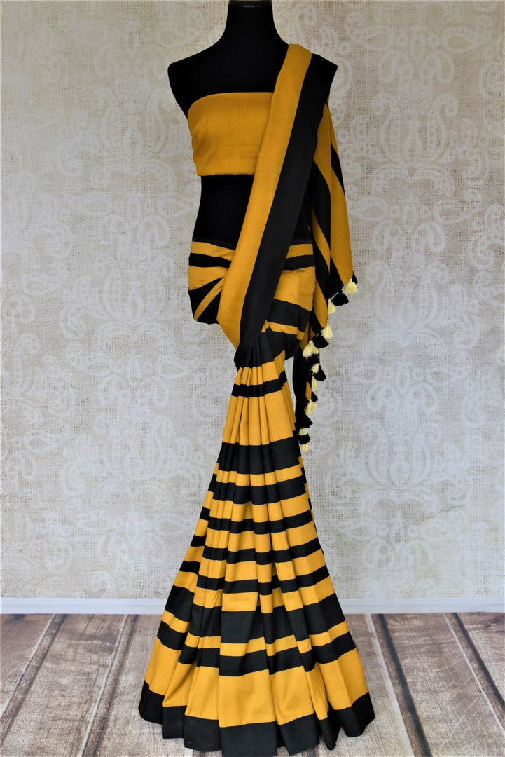 Shop stunning yellow and black stripes muga silk saree online in USA. Keep it light yet festive on special occasions with beautiful muga silk saris from Pure Elegance Indian fashion store in USA.-full view