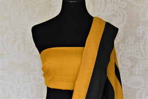 Shop stunning yellow and black stripes muga silk saree online in USA. Keep it light yet festive on special occasions with beautiful muga silk saris from Pure Elegance Indian fashion store in USA.-blouse pallu