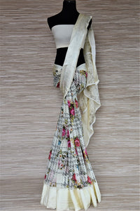 Shop off-white floral georgette saree online in USA with crepe border. Be the highlight of the parties and festive occasions with tasteful silk sarees, crepe saris, embroidered designer sarees from Pure Elegance Indian fashion store in USA.-full view