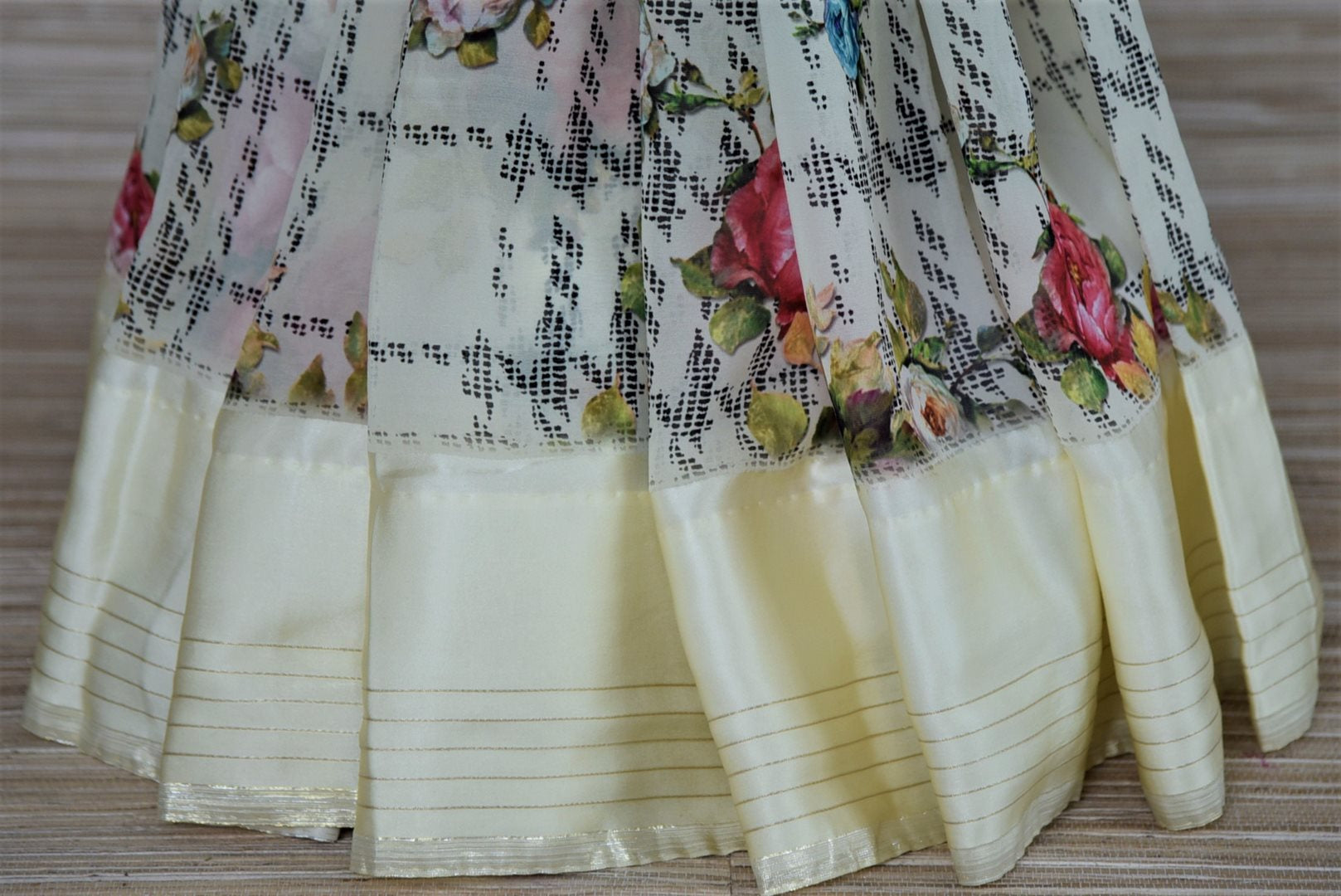 Shop off-white floral georgette saree online in USA with crepe border. Be the highlight of the parties and festive occasions with tasteful silk sarees, crepe saris, embroidered designer sarees from Pure Elegance Indian fashion store in USA.-pleats