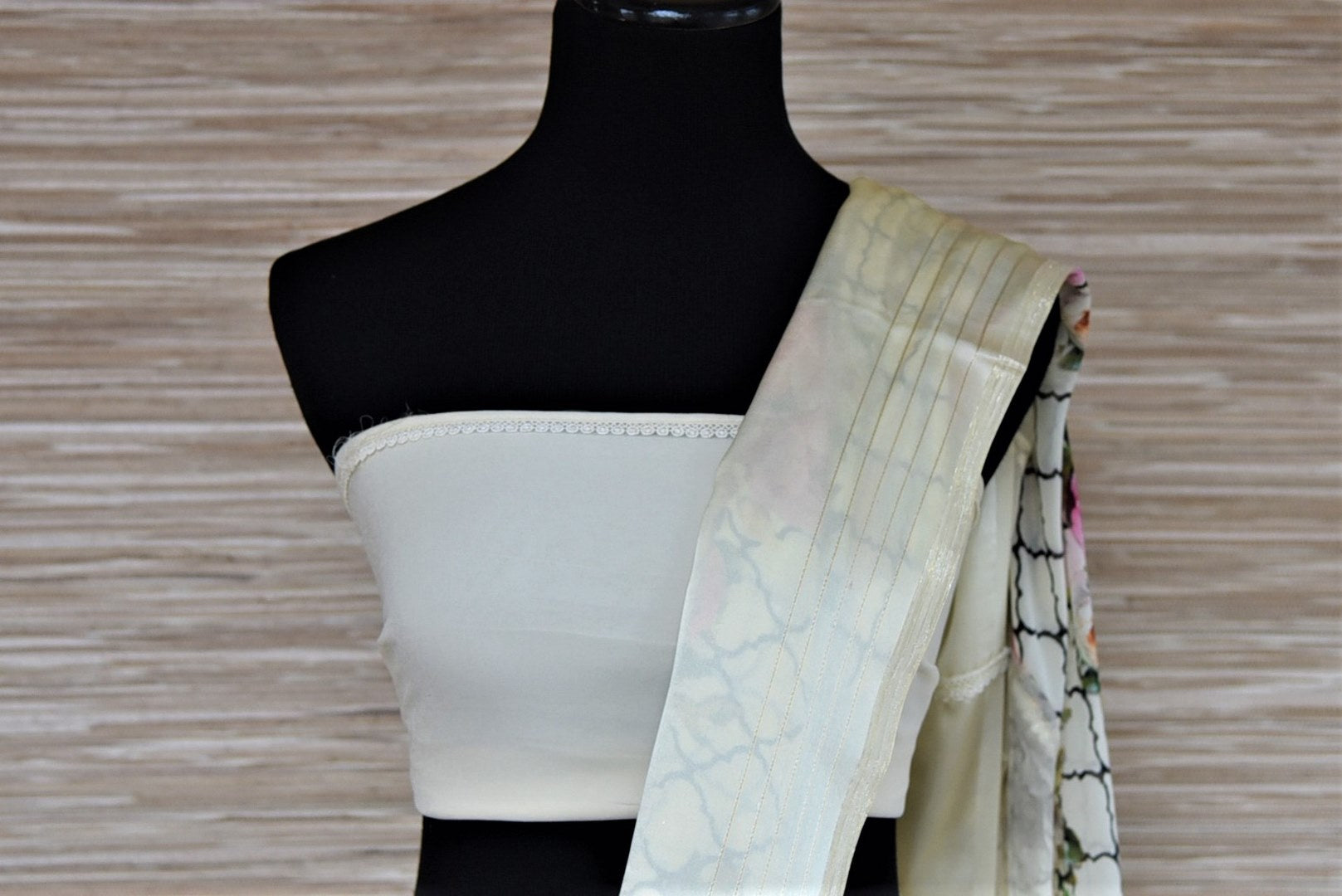 Buy alluring off-white floral print georgette sari online in USA with crepe border. Be the highlight of the parties and festive occasions with tasteful silk sarees, crepe saris, embroidered designer sarees from Pure Elegance Indian fashion store in USA.-blouse pallu