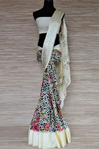 Shop off-white floral and polka dot georgette saree online in USA with crepe border. Be the highlight of the parties and festive occasions with tasteful silk sarees, crepe saris, embroidered designer sarees from Pure Elegance Indian fashion store in USA.-full view