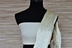 Shop off-white floral and polka dot georgette saree online in USA with crepe border. Be the highlight of the parties and festive occasions with tasteful silk sarees, crepe saris, embroidered designer sarees from Pure Elegance Indian fashion store in USA.-blouse pallu