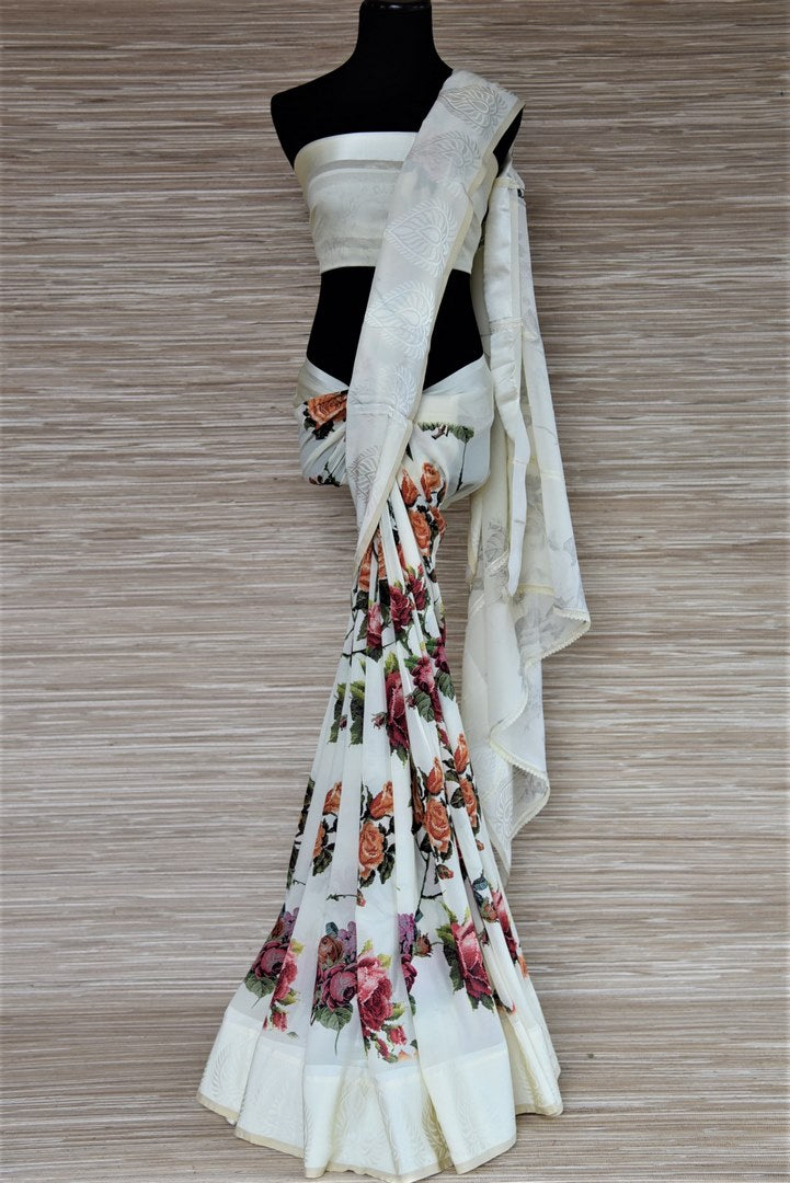 Buy off-white crepe border georgette saree online in USA with floral print. Be the highlight of the parties and festive occasions with tasteful georgette sarees, crepe saris, embroidered designer sarees from Pure Elegance Indian fashion store in USA.-full view