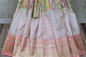 Buy gorgeous powder pink Banarasi silk saree online in USA with minakari zari paisley work. Enhance your festive look with pure silk sarees, Banarasi sarees, chanderi sarees in USA from Pure Elegance Indian clothing store in USA.-pleats