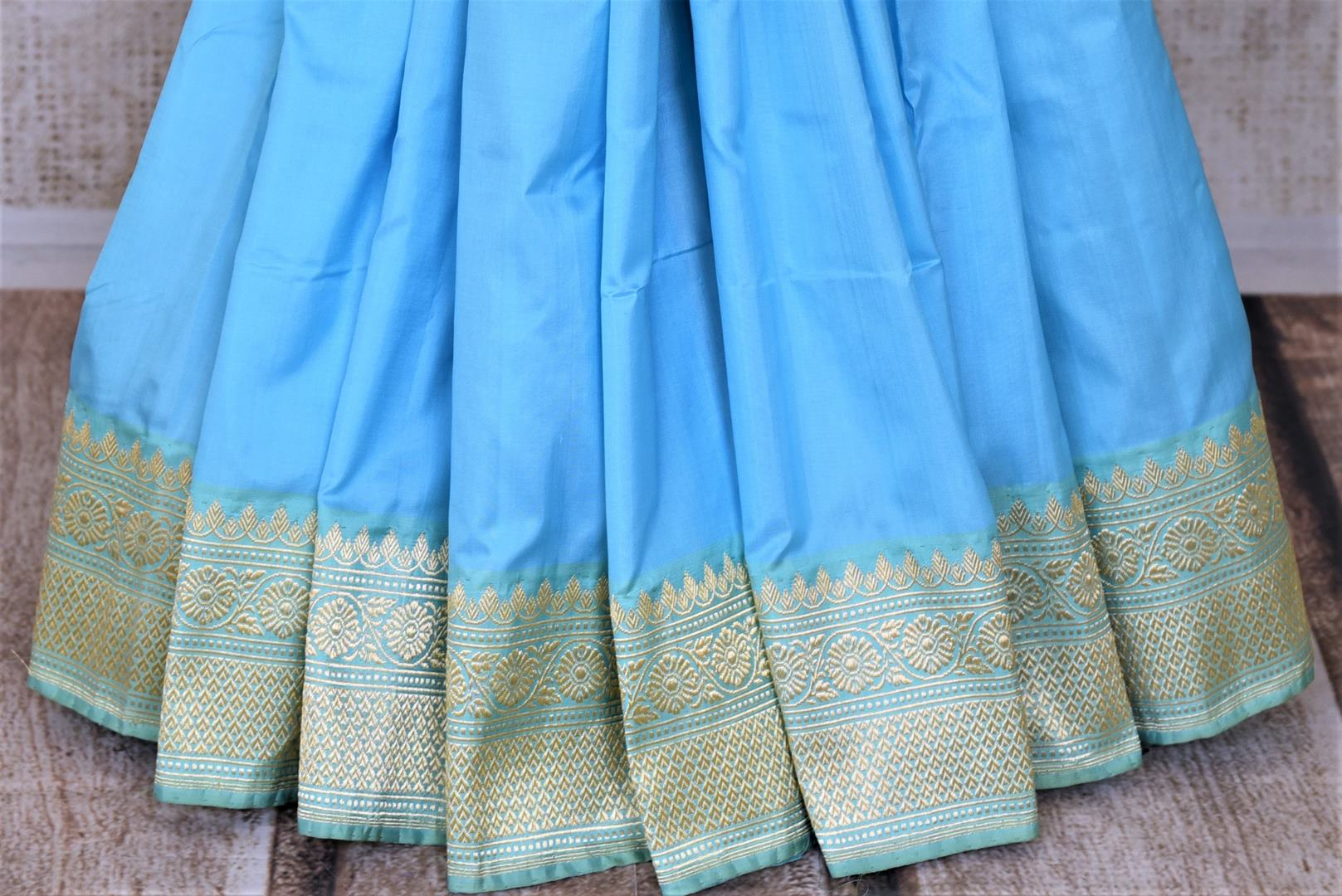Buy gorgeous light blue Banarasi silk sari online in USA with minakari zari floral motifs. Enhance your festive look with pure silk sarees, Banarasi sarees, chanderi sarees in USA from Pure Elegance Indian clothing store in USA.-pleats