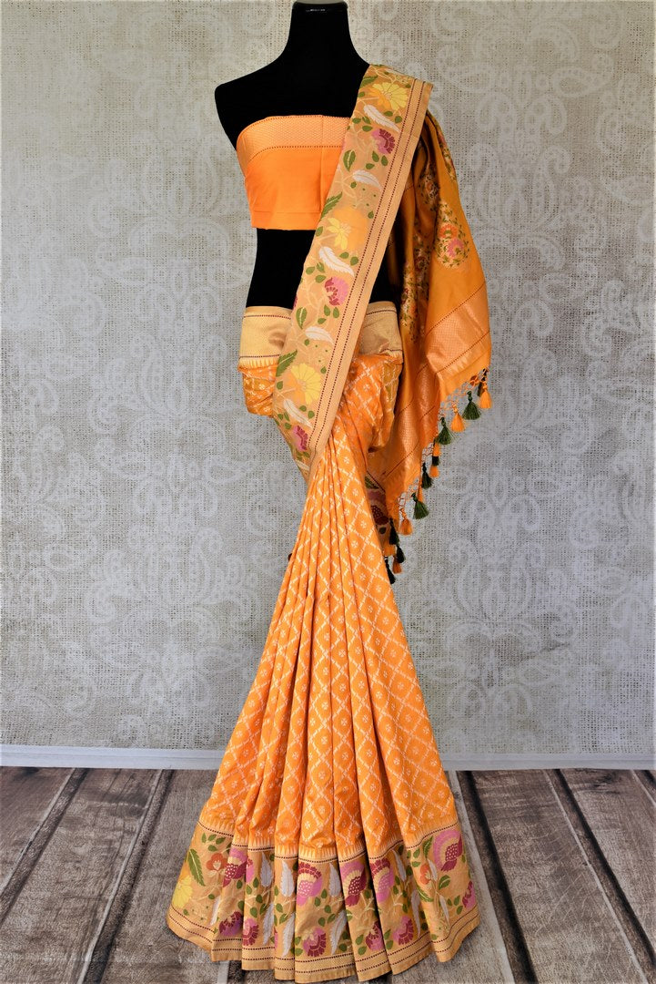 Shop stunning yellow Banarasi silk saree online in USA with zari and minakari floral border. For Indian women in USA, Pure Elegance Indian fashion store brings an exquisite collection Banarasi sarees, Banarasi silk sarees, tussar sarees, zari work sarees, pure silk sarees all under one roof. Shop online now.-full view