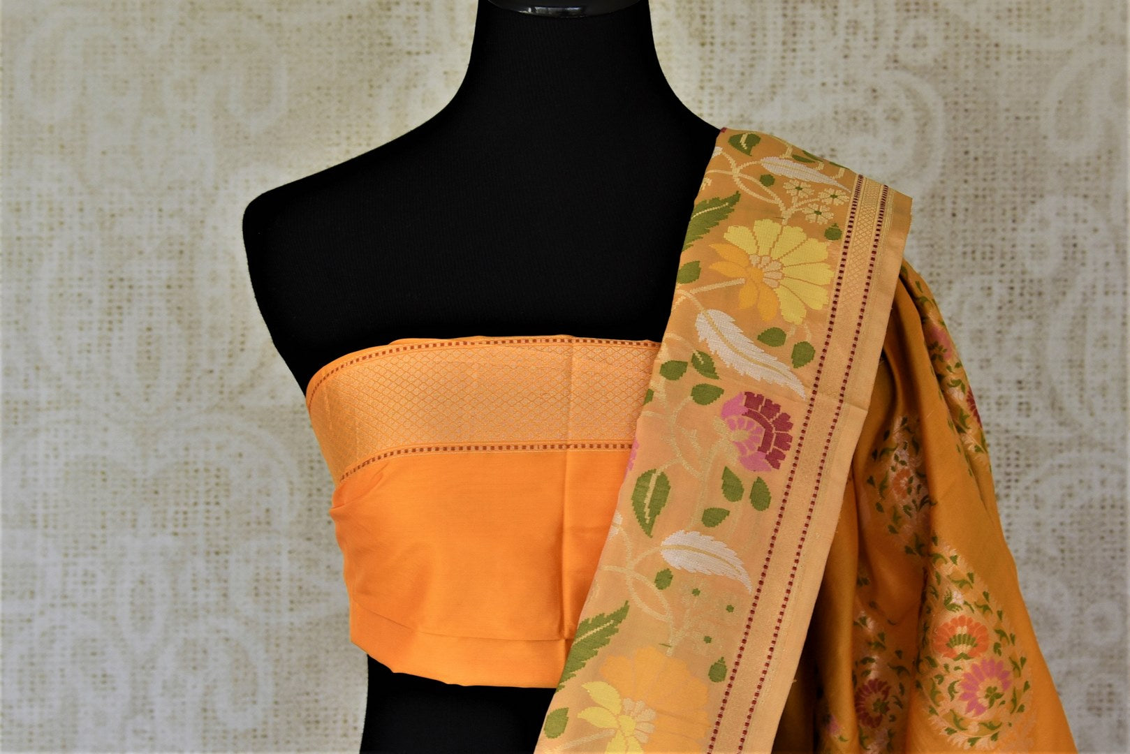 Shop stunning yellow Banarasi silk saree online in USA with zari and minakari floral border. For Indian women in USA, Pure Elegance Indian fashion store brings an exquisite collection Banarasi sarees, Banarasi silk sarees, tussar sarees, zari work sarees, pure silk sarees all under one roof. Shop online now.-blouse pallu