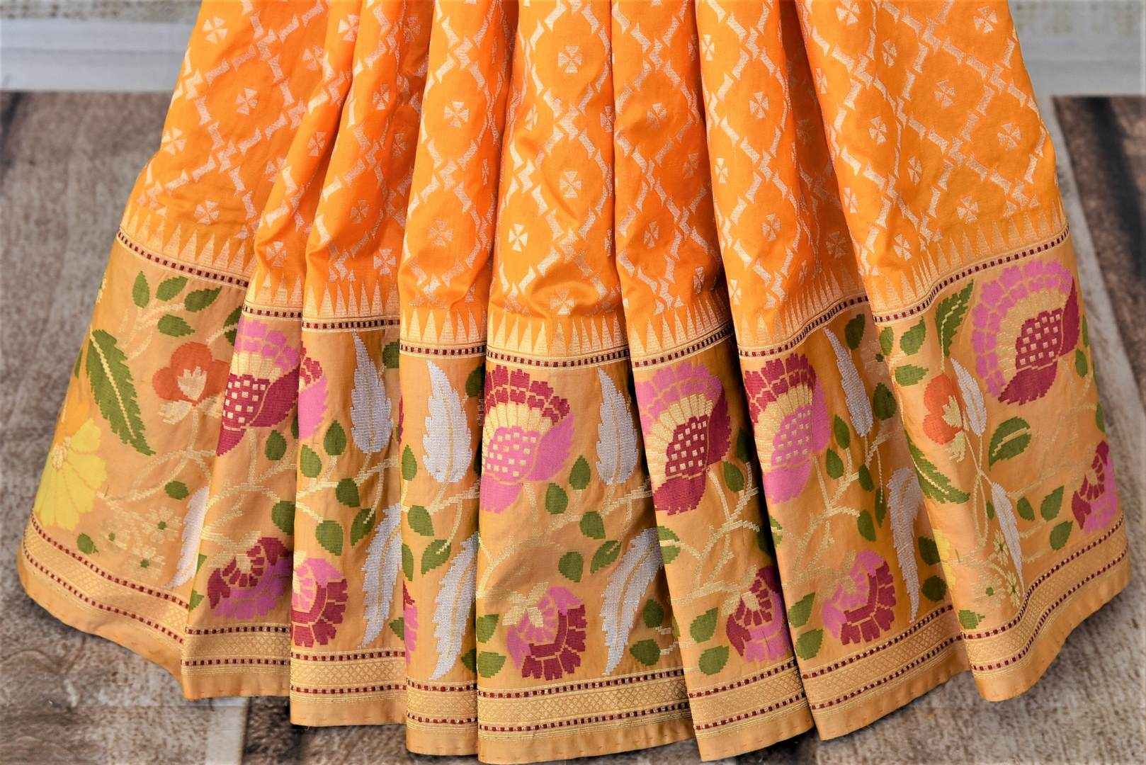 Shop stunning yellow Banarasi silk saree online in USA with zari and minakari floral border. For Indian women in USA, Pure Elegance Indian fashion store brings an exquisite collection Banarasi sarees, Banarasi silk sarees, tussar sarees, zari work sarees, pure silk sarees all under one roof. Shop online now.-pleats