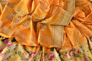 Shop stunning yellow Banarasi silk saree online in USA with zari and minakari floral border. For Indian women in USA, Pure Elegance Indian fashion store brings an exquisite collection Banarasi sarees, Banarasi silk sarees, tussar sarees, zari work sarees, pure silk sarees all under one roof. Shop online now.-details