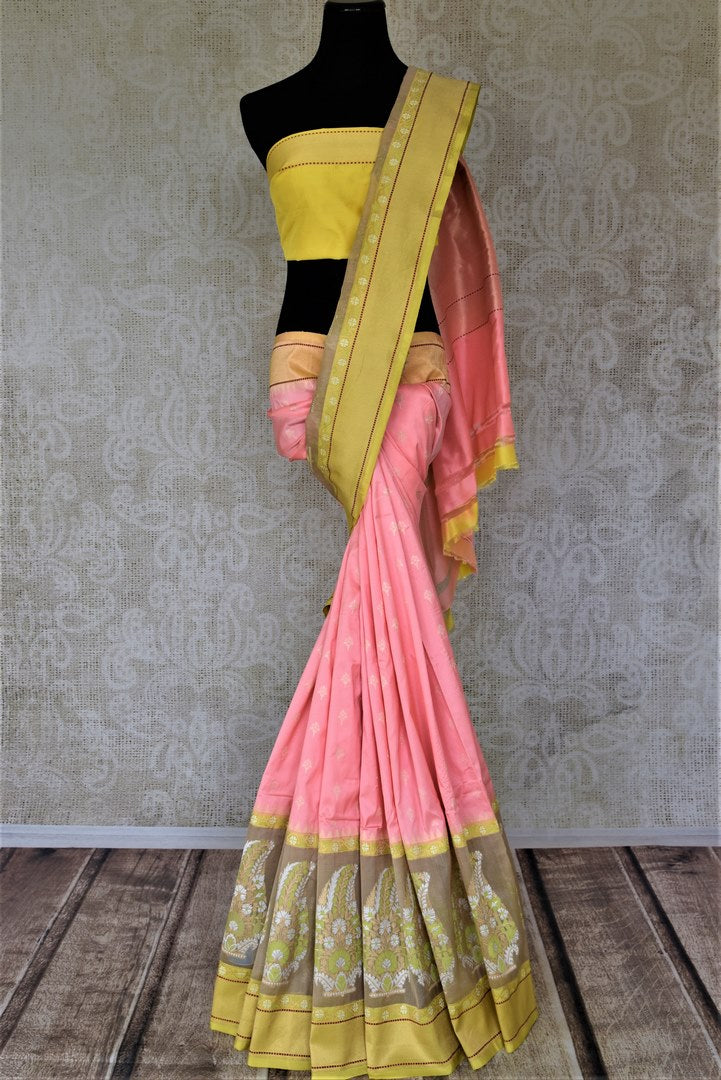 Buy beautiful pastel pink Banarasi silk saree online in USA with floral minakari zari buta on border. For Indian women in USA, Pure Elegance Indian fashion store brings an exquisite collection Banarasi sarees, Banarasi silk sarees, tussar sarees, zari work sarees, pure silk sarees all under one roof. Shop online now.-full view