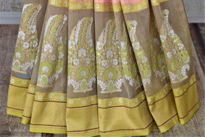 Buy beautiful pastel pink Banarasi silk saree online in USA with floral minakari zari buta on border. For Indian women in USA, Pure Elegance Indian fashion store brings an exquisite collection Banarasi sarees, Banarasi silk sarees, tussar sarees, zari work sarees, pure silk sarees all under one roof. Shop online now.-pleats