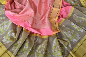 Buy beautiful pastel pink Banarasi silk saree online in USA with floral minakari zari buta on border. For Indian women in USA, Pure Elegance Indian fashion store brings an exquisite collection Banarasi sarees, Banarasi silk sarees, tussar sarees, zari work sarees, pure silk sarees all under one roof. Shop online now.-details