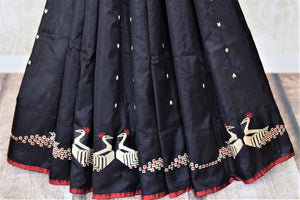 Buy gorgeous black Banarasi silk saree online in USA with zari peacock design on border. Enhance your festive look with pure silk sarees, Banarasi saris, chanderi sarees in USA from Pure Elegance Indian clothing store in USA.-pleats