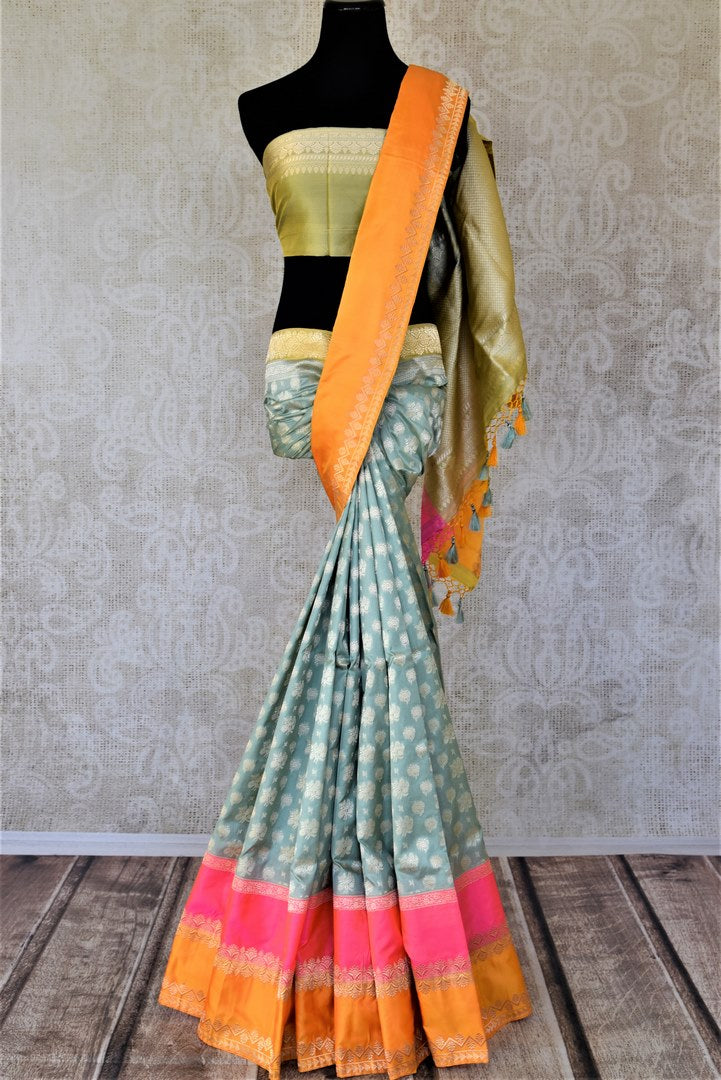 Buy beautiful sea green zari work Banarasi silk saree online in USA with pink and orange border. For Indian women in USA, Pure Elegance Indian fashion store brings an exquisite collection Banarasi sarees, Banarasi silk sarees, tussar sarees, zari work sarees, pure silk sarees all under one roof. Shop online now.-full view