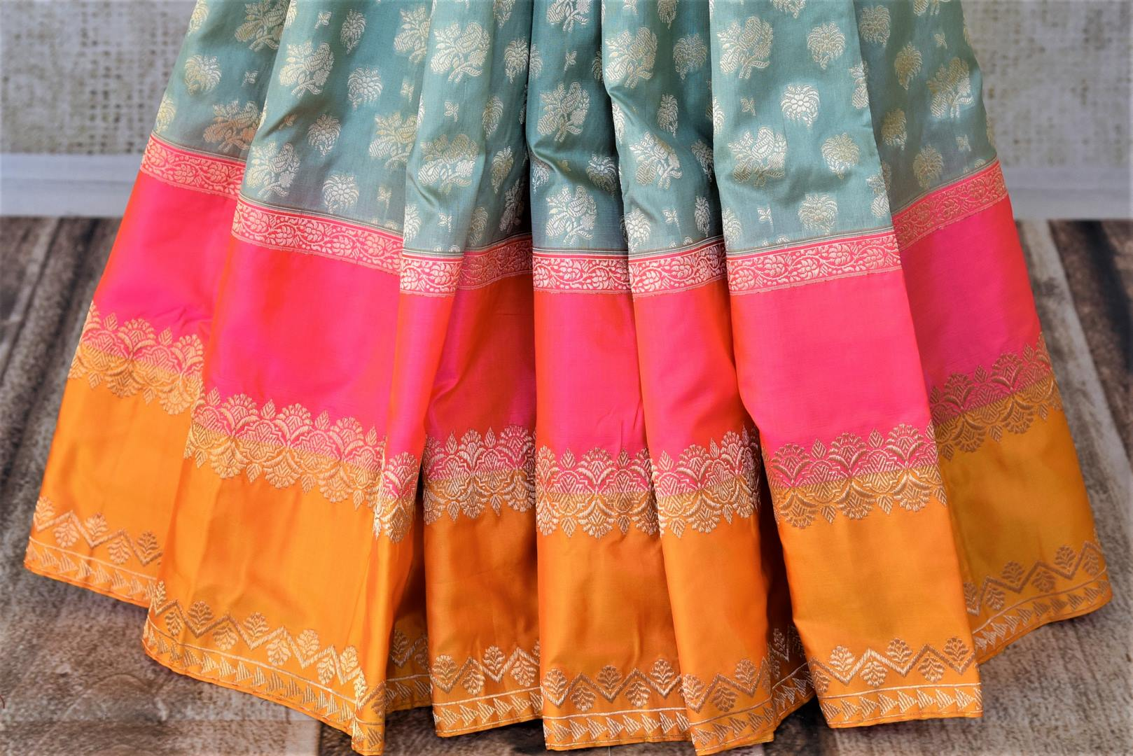 Buy beautiful sea green zari work Banarasi silk saree online in USA with pink and orange border. For Indian women in USA, Pure Elegance Indian fashion store brings an exquisite collection Banarasi sarees, Banarasi silk sarees, tussar sarees, zari work sarees, pure silk sarees all under one roof. Shop online now.-pleats